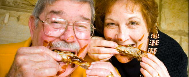 people eating ribs